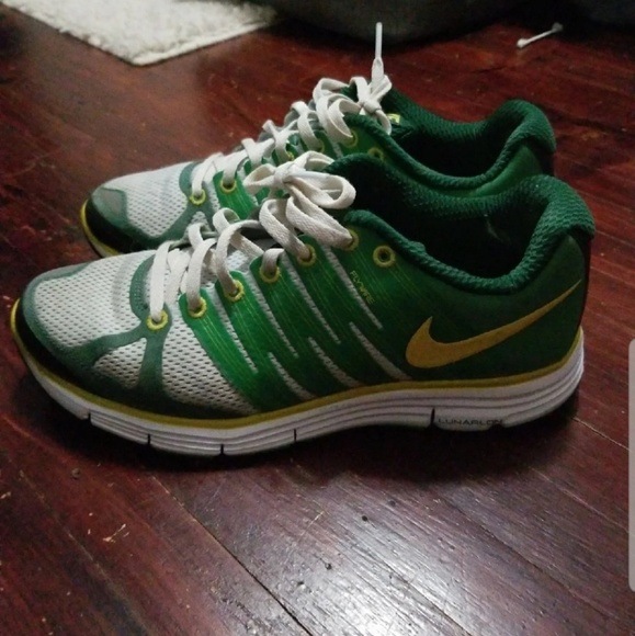 Nike Shoes - Green Nike sneakers with yellow accents